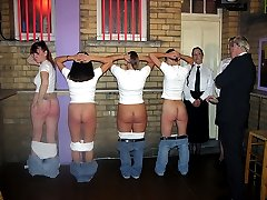 Four girls bend over for a spanking with their knickers around their ankles
