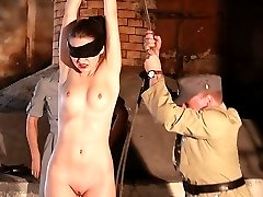 Blindfolded beauty gets lashed