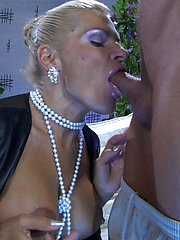 Gorgeous big-breasted milf straddles a younger guy after some oral exchange