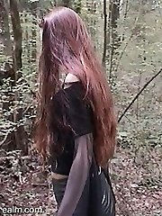 Fledgling babe in short skirt in the forest