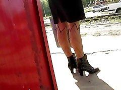 She looks like whore in short skirt