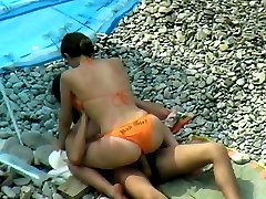 Lucky dude impales a busty beach chick on his tool