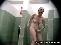 Naughty-lookingchick shot naked while paying attention to her pussy in shower