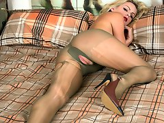 Luscious blonde Vanessa is wearing some unusual olive green sheer pantyhose showing her stunning figure!