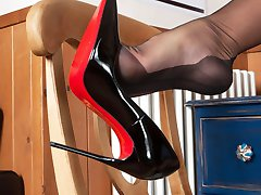 Natalia takes a call from a client who remembers her sheer black full fashion nylons and designer heels very well.