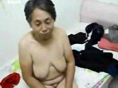 Asian Grandma get dressed after hump