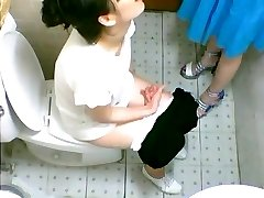 Two cute Japanese girls spotted on a toilet cam pissing