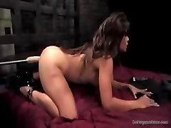 Brunette gets in different postures to let this machine tear up her