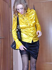 Leggy girl changes into a new pair of stockings to go with her silky outfit