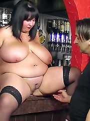 Fat sexy barmaid hooks up with a client who eats and fucks her on the counter