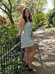 Brown-haired babe Lauryn taunting in the park in a pair of fully fashioned nylons and black high-heeled slippers
