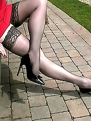 A sexy leg show in lace top stockings and a short dress. Louise's shoes are pointed with very thin heels, give in to your fetish and kneel before her as you lust at her feet