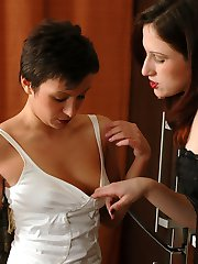 Sensual lesbi girlfriends clad in white and black stockings kissing it down