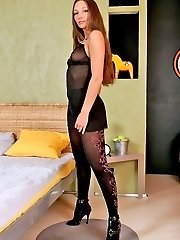 Leggy brunette Maria in fashion pantyhose lying on couch and stretching legs