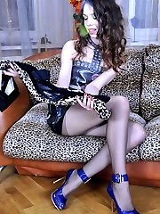 Hot seductress choosing an outfit to mach her classy control top pantyhose