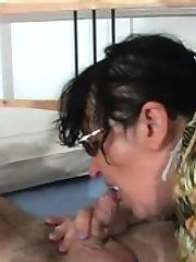 Curly haired mom gives a skilful deepthroating to younger dude