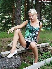 Girl plays her pantyhose up skirt
