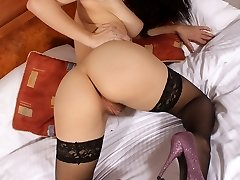 Roxy Mendez plays on the bed in her gorgeous lingerie and basque before disrobing off and peeling down her undies to spread and penetrate her hairy cootchie with her electro-hitachi