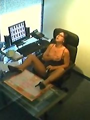 Office girl getting off at her desk at work