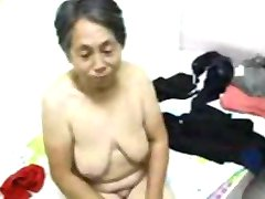 Asian Grandma get dressed after sex
