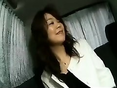 Enticing Japanese lady flashes her pleasing titties and sucks a