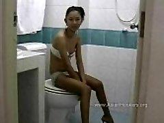 Thai Hooker Deepthroats Cock in the Toilet