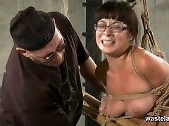 Bound and tied sub in glasses has orgasms