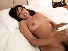 Stunning Asian girl with marvelous gigantic boobies gives a sensua