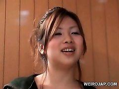 Asian teenage hotties flashing sumptuous legs in mini skirts outdoor