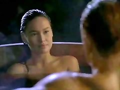 Asian Tia Carrere heads for Dolph Lundgrens Big Blond Rod