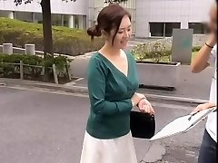 Friendly Chinese lady keeps smiling while her cleavage is totally revealed