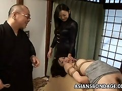 Tied up Japanese babe gets smacked and dildo fucked