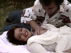 Retro porno shows a plump girl getting boned outside