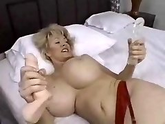 Chesty mature tastes a black trunk and a dildo