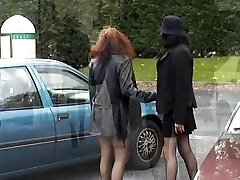 Two honeys demonstrating their tits and pussy in public place