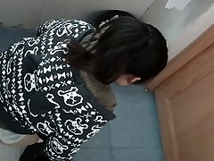 an Asian chick in a jumper peeing in public rest room for absolute ages