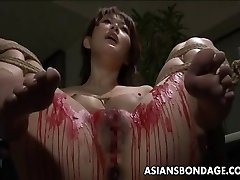 Asian babe get her privates frosted in wax.