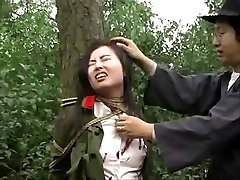 Asian army girl tied to tree 1