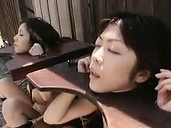 Vulnerable Oriental chicks getting their mouths wedged with