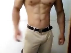 Hot muscle man flex and grip his bulge