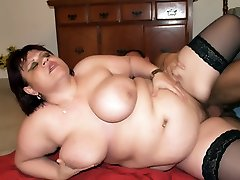 Old babe in nylons Marta cupping her breasts while a bear penetrates her on the floor