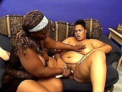 Black lesbian fatties Snapps and Beauty hook up and pound each others pussy with a large sex toy