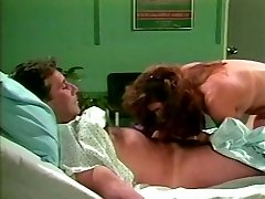 Dark haired lut leaps on wood of one patient in a hospital