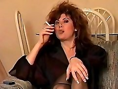 Classic early 90's smoking with huge hair, brilliant.