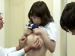 Noisy oriental schoolgirl getting finger-tickled by her doc on the medical couch