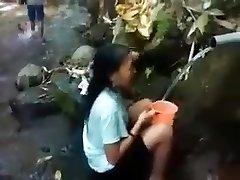 Indonesia girl outdoor nature bathroom