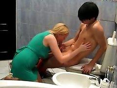 Slutty blonde woman in green mini sundress fucks with her Asian BF in bath