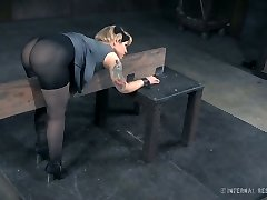 Sexy tattooed bitch in nylons is fucked in the dungeon space
