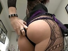 Lustful brunette wearing crotchless tights disrobes on a camera
