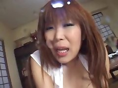 Asian girl has fun with some toys and squirts